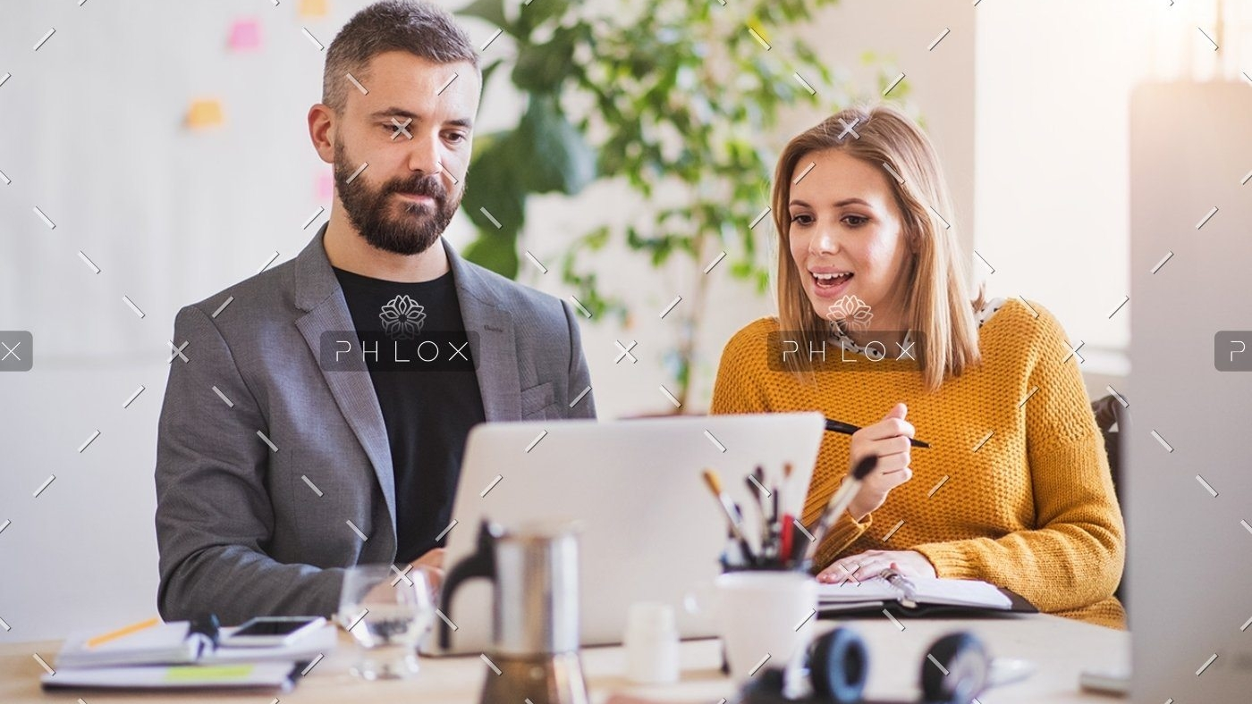 demo-attachment-408-two-business-people-with-wheelchair-in-the-office-P7XLSBC